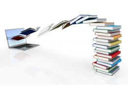 0115 Books Flying Towards Laptop Stock Photo