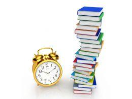 0115 Multiple Books And Alarm Clock Stock Photo