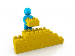 0914 Blue 3d Men Yellow Blocks Wall Puzzle Toy Image Graphic Stock Photo