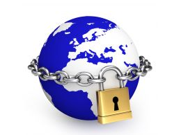 0914 Blue Globe With Golden Padlock And Silver Chain Stock Photo