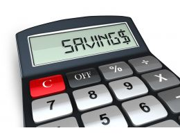 0914 Calculator With Word Savings Symbolizing Financial Security Stock Photo