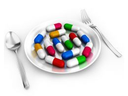 0914 Capsules On Plate With Fork And Spoon For Healthcare Stock Photo