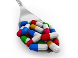 0914 Colorful Capsules On Silver Spoon For Healthcare Stock Photo