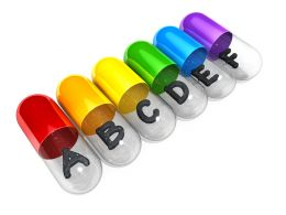 0914 Colorful Capsules With Letters On White Background Stock Photo