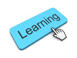 0914 Computer Cursor Pointing At Learning Word Stock Photo