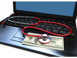 0914 Dollars And Stethoscope On Laptops Keyboard Stock Photo