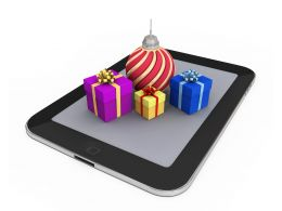 0914 Gifts And Christmas Ball On Pc Tablet Stock Photo