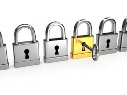 0914 Golden Lock With Key Along With Silver Locks Stock Photo