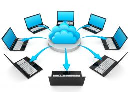 0914 Laptop Computers Connected Through Cloud Computing Stock Photo