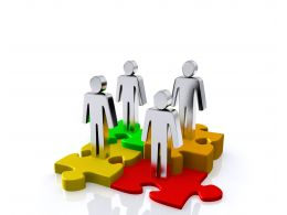 0914 Men Standing On Puzzle Pieces For Teamwork Stock Photo