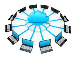 0914 Network Of Laptops Connected Around Cloud For Cloud Computing Stock Photo