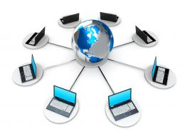 0914 Network Of Laptops Connected To Globe Stock Photo