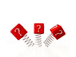 0914 Question Marks On Red Cubes And Springs Graphic Stock Photo