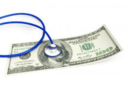 0914 Stethoscope On 100 Dollar Note For Checking Stock Photo