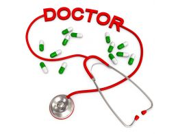 0914 Stethoscope With Doctor Word And Medical Pills Stock Photo