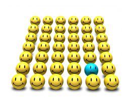 0914 Yellow Smileys With Single Blue Smiley Image Slide Stock Photo