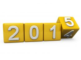 0914 Yellow Turning Cubes For New Year 2015 Stock Photo