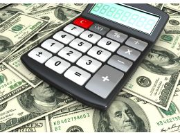 1114 Calculator On Us Currency Notes Stock Photo