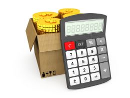 1114 Coins In Carton Box With Calculator Stock Photo