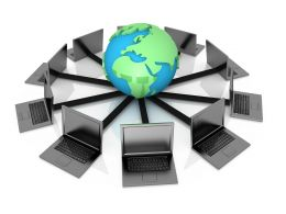 1114 Globe And Laptops For Computer Networking Stock Photo