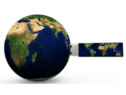 1114 Globe And Pen Drive For Global Data Storage Stock Photo