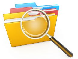 1114 Magnifying Glass Over Computer Folders Stock Photo
