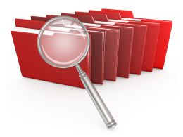 1114 Red Computer Folders With Magnifying Glass Stock Photo