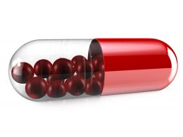 1114 Red Glass Capsule On White Background Stock Photo