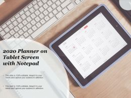 2020 Planner On Tablet Screen With Notepad