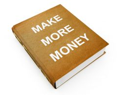 3D Book With Making More Money Stock Photo