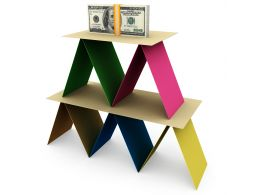 3D Colored Card Pyramid With Dollar Bundle On Top Stock Photo