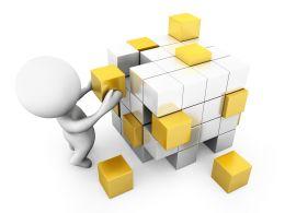 3D Man Building Cube Stock Photo