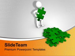 3d Man Completing Puzzles Business Concept Powerpoint Templates Ppt Themes And Graphics 0113