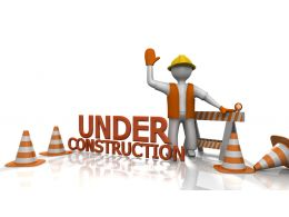 3d Man Showing Under Construction Text With Traffic Cones Stock Photo