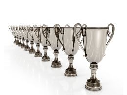3d Silver Winner Trophies Standing In A Row Stock Photo