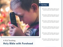 A Kid Touching Holy Bible With Forehead