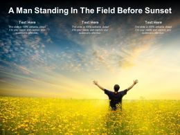 A man Standing In The Field Before Sunset