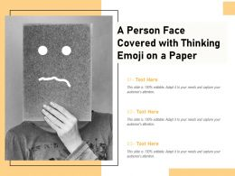 A Person Face Covered With Thinking Emoji On A Paper