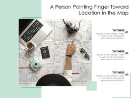 A Person Pointing Finger Toward Location In The Map