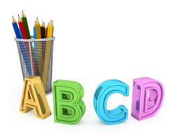 Abcd Letters With Holder Of Pencils Stock Photo