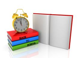 Alarm Clock On Books For Preschool Education Stock Photo