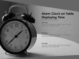 Alarm Clock On Table Displaying Time