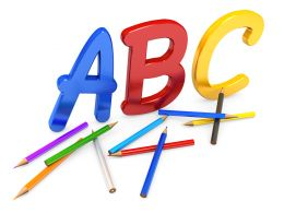 Alphabets With Colored Pencils Stock Photo