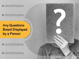 Any Questions Board Displayed By A Person
