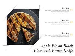 Apple Pie On Black Plate With Butter Knife