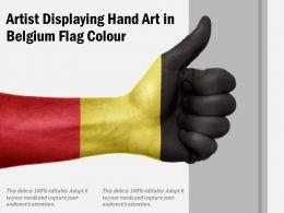 Artist Displaying Hand Art In Belgium Flag Colour