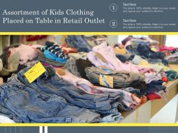 Assortment Of Kids Clothing Placed On Table In Retail Outlet