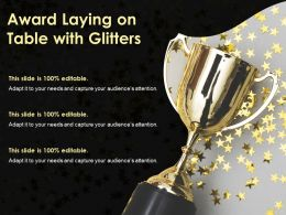 Award Laying On Table With Glitters