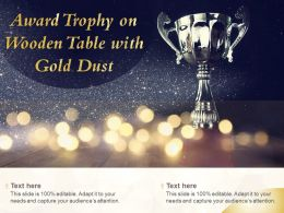 Award Trophy On Wooden Table With Gold Dust