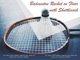 Badminton Racket On Floor With Shuttlecock
